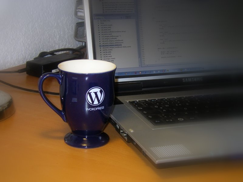 Wet with his WordPress cup.